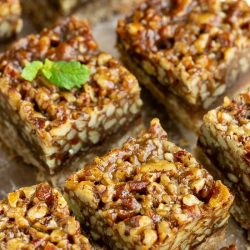 Enjoy these Mexican-style Pecan-Chocolate Squares that are packed with pecans. They're easy to make, easy to transport, and great for year around noshing.