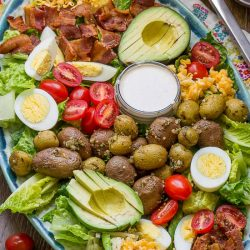 Best Cobb Salad with Buttermilk Garlic Dressing is a hearty, satisfying main dish salad, with plenty of proteins, good fats, flavor, and a delicious dressing.