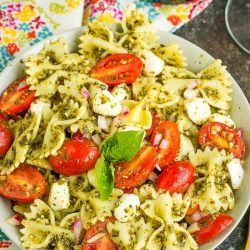 Bowtie Pesto Pasta Salad combines Caprese salad and basil pesto with pasta for a quick, easy, and delicious pasta salad.