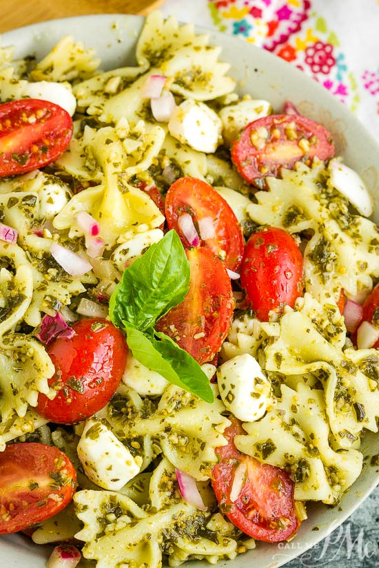 Bowtie Pesto Pasta Salad combines Caprese salad and basil pesto with pasta for a quick, easy, and delicious pasta salad.