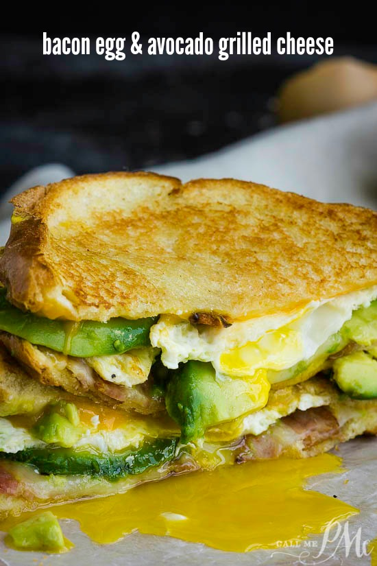 Double Fisted Fried Egg Bacon Avocado Grilled Cheese Sandwich - take your grilled cheese to a new level! This sandwich recipe is loaded with melty cheese, buttery avocado, crispy bacon, and a fried egg!