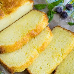 The perfect sweet treat, Copycat Sara Lee Pound Cake Recipe is moist, buttery, has a hint of lemon, and melts in your mouth. #southern #PaulaDeen This recipe makes one loaf. #SaraLee #copycat #poundcake #cake #dessert #recipe #lemon #easy #fromscratch #homemade #poundcakerecipemoist #creamcheese #milliondollar