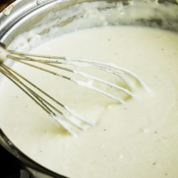 Low Carb Cheese Sauce, a Keto sauce, is a great base sauce. Try it in lasagna and other pasta recipes, gratins, vegetables, chicken, or steak. It's a staple for low-carb eating.
