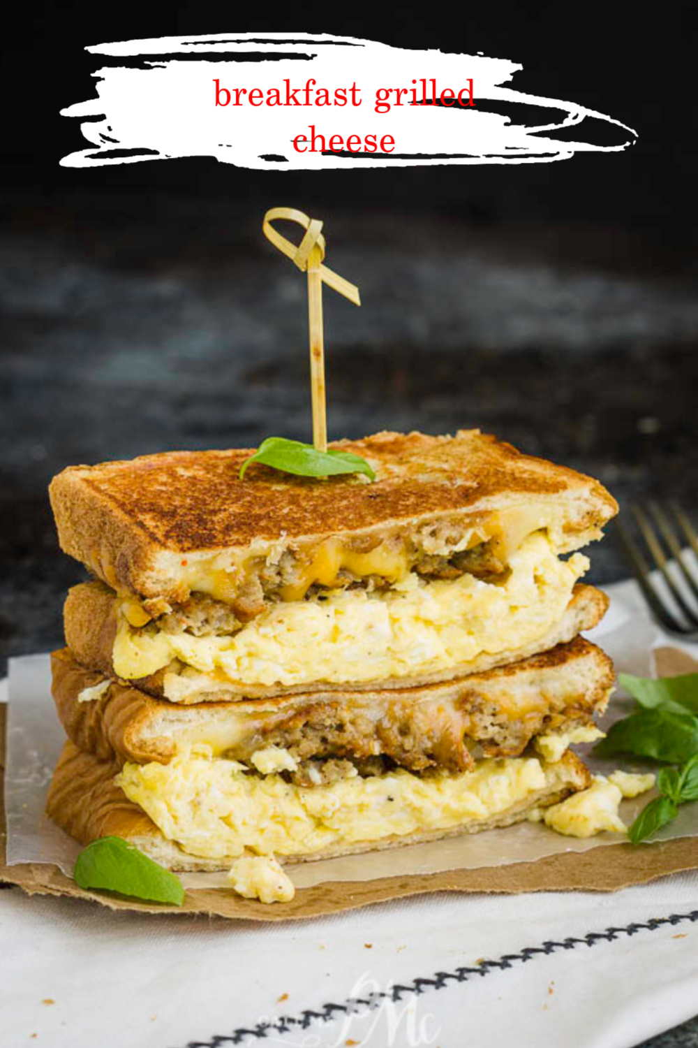 A savory, indulgent sandwich, Breakfast Grilled Cheese Recipe with soft scrambled eggs and sausage, will have you looking forward to breakfast. #breakfast #eggs #scrambledeggs #sauasage #grilledcheese #recipe