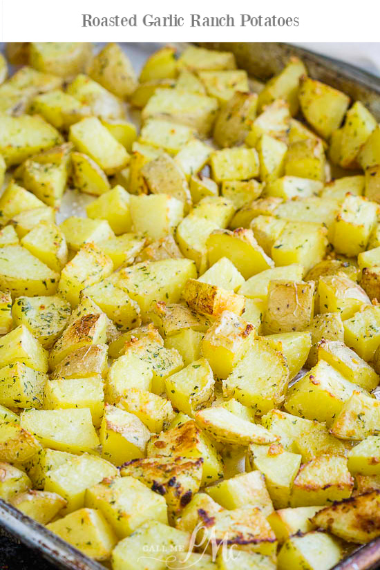 Roasted Garlic Ranch Potatoes is an economical & easy side dish recipe that goes with any meal. They're seasoned with ranch & parmesan! #roasted #potato #recipe #ranch #seasoning #garlic #baked #red #oven #easy #parmesan #airfryer