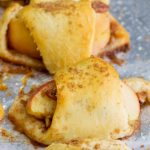 Easy Apple Pie Bites Recipe is a super quick way to enjoy the taste of apple pie in 25 minutes! This simple, easy, & fast will become your go-to snack, dessert, or breakfast. #apples #dessert #pie #applepie #recipe #easy #mini #crescentrolls #crusts #pecans