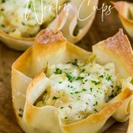 Green Chile Cheese Wonton Cups are an easy appetizer made with a muffin tin, wonton wrappers, and delicious green chile dip! #dip #greenchile #wontons #wontoncups #appetizer #recipe #corn #cheese #easy