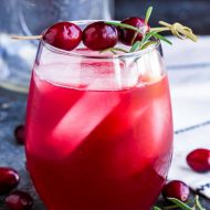 Rudolph's Tipsy Punch is a festive holiday vodka drink. This Christmas cocktail recipe is great for party entertaining and it can easily be made kid-friendly. #punch #drink #cocktail #punch #party #recipe #vodka #cranberry