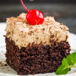Chocolate Mousse Cake Recipe has a rich chocolate cake topped with a simple to make chocolate mousse that's light and fluffy tops this sheet cake. #cake #chocolate #homemade #fromscratch #easy #mousse #ganache #best #dark #layered