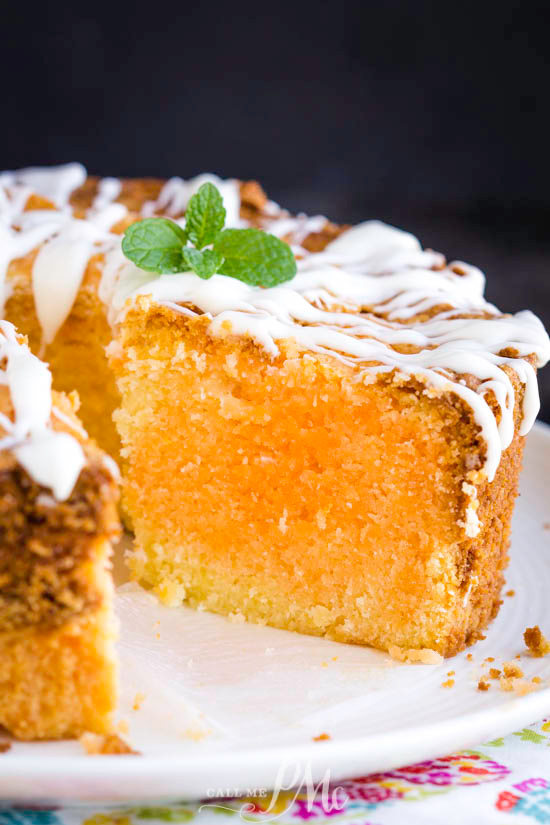 Orange Creamsicle Pound Cake has a bright citrus flavor and a cream soda glaze that you can't stop eating! It's dense, butter, and velvety smooth. #cake #poundcake #poundcakepaula #dessert #recipe #easy #creamsicle #orange #orangecreamsicle #homemade #southern #food #eat #creamcheese #buttermilk