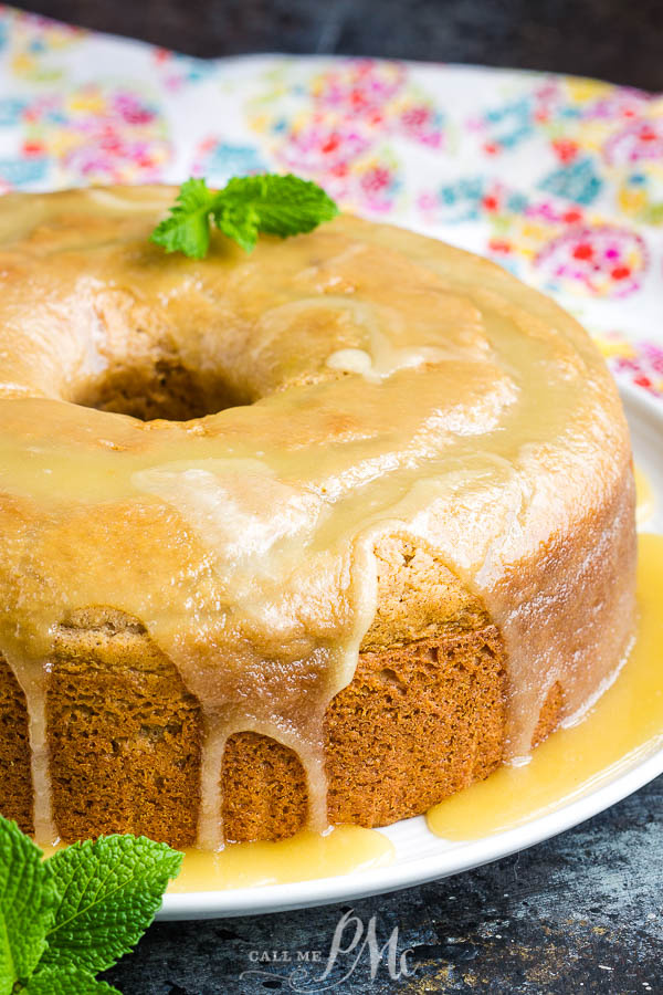 This delicious Cinnamon Crack Cake Recipe is spiced with cinnamon and topped with a rich butter sauce. #cake #bundtcake #dessert #cinnamon #recipes