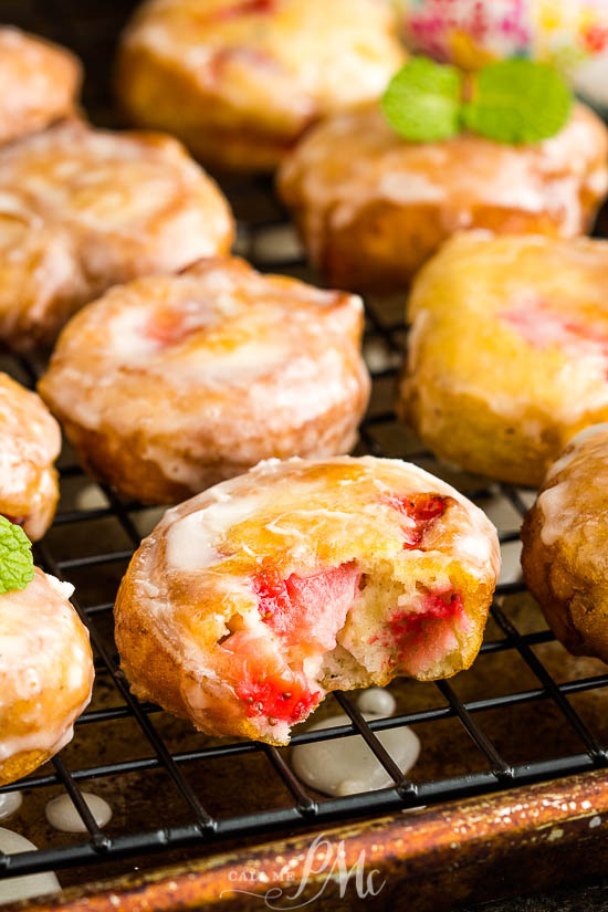 Highly addictive, Glazed Strawberry Fritters are crispy on the outside while being soft, fluffy, and loaded with strawberries on the inside. #recipe #fritters #strawberry #donut #doughnut #recipe #dessert #breakfast #homemade
