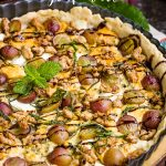 This savory Blue Cheese Grape Tart recipe has bold and interesting flavors. It makes a great appetizer or a decadent lunch paired with a green salad. #bluecheese #tart #grapes #redwine #walnuts #candiedwalnuts #appetizer #recipe #Vintijrestaurant #Vintij