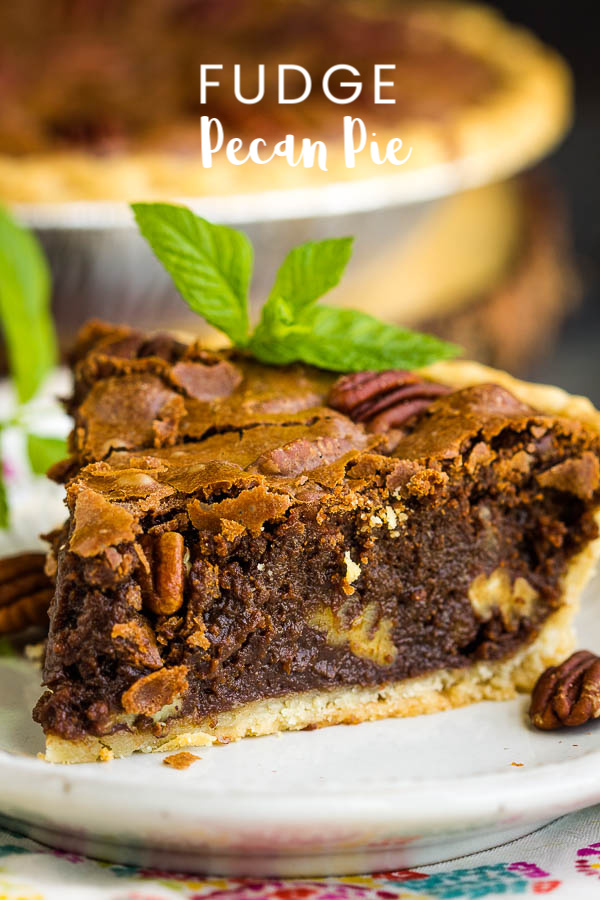 Rich, indulgent, and gooey, Chocolate Fudge Pecan Pie Recipe is quick and easy, requires no mixer, and has no corn syrup! It's a delicious new classic! #chocolate #fudge #pecan #pecanpie #chocolatepie #dessert #recipe
