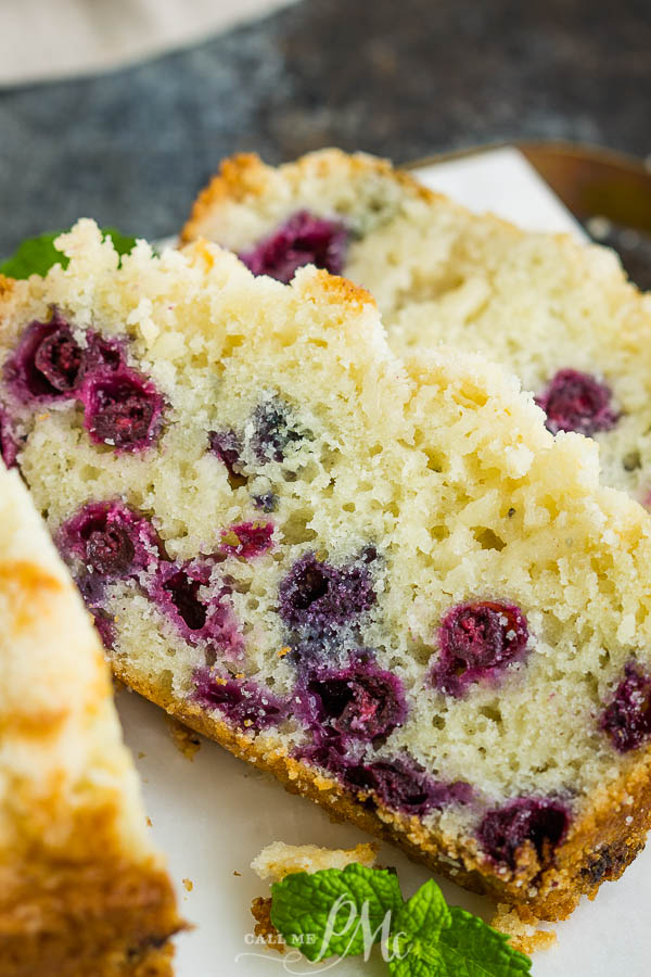 Lemon Blueberry Streusel Bread has a bright lemon flavor and is soft, moist, loaded with blueberries, and topped with the best crumb topping! #blueberry #bread #dessert #crumbtopping #streusel #baking #recipe #callmepmc
