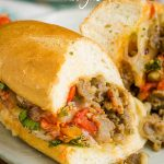 Sausage Pepper Onion Hoagies a delicious, hearty 30-minute meal! Italian sausage, onions, peppers, tomato sauce, and lots of mozzarella make this sandwich a family favorite. #sausage #sandwich #Italian #hoagie #pizza #pizzasandwich #pizzahoagie #pepeprs #onions #Italiansausage #easy #20minute #recipe