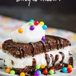 SuzyQ Dessert Stack Recipe is an ice cream treat that starts with a pre-made chocolate cake then layered with ice cream and chocolate. #dessert #chocolate #Hostess #snackcake #callmepmc