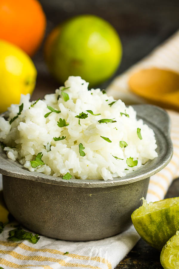 Chipotle's Cilantro Lime Rice Recipe is light, zesty, and fresh. This side dish brightens any meal and it's so easy to make! #lime #rice #cilantro #recipe #sidedish #Chipotle #copycat #TexMex