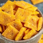 FIRECRACKER CHEEZ ITS recipe takes just four ingredients and less than 30 minutes. Snack fanatics will love these crunchy, cheesy, and salty crackers! #firecracker #ranch #redpepper #recipe #snack #cheezIts #recipeshomemade #homemade #howtomake #simple #mix
