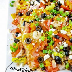 Greek Seafood Nachos are a delicious Mediterranean twist on a snack or dinner recipe. They are a fun and simple dinner solution full of fresh ingredients and flavor! #recipes #Greek #nachos #seafood #shrimp #crawfish #feta #easy #tailgating #party