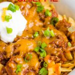 Frito Chili Pie Recipe is classic comfort and gameday food. It's simple, hearty, delicious, takes just minutes to make, and the whole family loves it! #cornchips #Fritos #chips #chili #cheese #cheddar #meal #fastfood #copycat