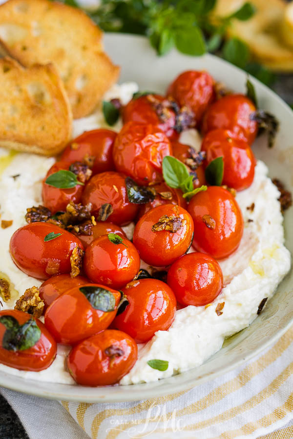 Whipped Feta with Blistered Tomatoes, In this recipe, whipped feta adds a creamy and salty zing and is perfectly balanced by the slightly sweet blistered tomatoes! #feta #cheese #dip #spread #recipe #tomato #grapetomato #cherrytomatoes #appetizer #easy #bruschetta