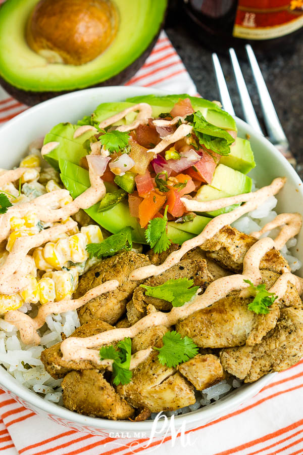 Fajita Chicken Bowl Recipe is quick and easy to make, healthy chipotle style bowls loaded with cilantro rice, fajita chicken, pico filled avocado half,  street corn, and Chipotle Ranch. #fajitabowl #chicken #TexMex #healthy #healthyfood #healthymeal #cilantro #streetcorn #avocado #chipotleranch #easy #grilled #grilledchicken