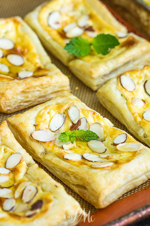Almond Puff Pastry Danish takes advantage of premade puff pastry for the no-fail pastry base that's filled with a cream cheese honey mixture and topped with almond slivers. #puffpastry #danish #recipe #breakfast #brunch #dessert #almond #baked #homemade #semihomemade