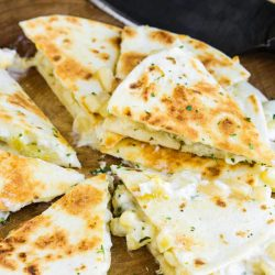 Green Chile Cheese Quesadillas are filled with gooey cheese, zesty green chilies, and toasted in a flour tortilla. #quesadilla #TexMex #greenchile #corn #cheese #dinner #easy #lunch #recipe