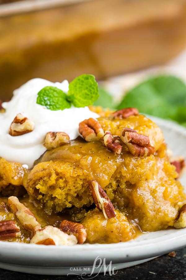 The perfect fall dessert, Pecan Pumpkin Cobbler Recipe has a sweet, creamy pumpkin custard as the base layer. It's topped with a buttery cobbler and oozing with rich, gooey caramel. #cobbler #pecan #pumpkin #recipe #dessert #baked #baking #easy #falldesserts