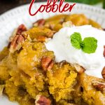 The perfect fall dessert, Pecan Pumpkin Cobbler Recipe has a sweet, creamy pumpkin custard as the base layer. It's topped with a buttery cobbler and oozing with rich, gooey caramel. #cobbler #pecan #pumpkin #recipe #dessert #baked #baking #easy #falldesserts