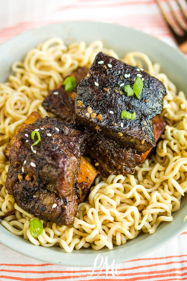 Tender, fall-off-the-bone Braised Korean Spicy and Sweet Short Ribs are sautéed then slow-cooked in a rich Korean marinade. #shortribs #ribs #Koreanfood #recipe #sweetheat #sweetspicy #spicysweet #Asian #slowcooker
