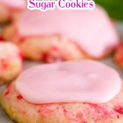 Frosted Amish Cherry Sugar Cookies are crispy around the edges yet pillowy soft and chewy inside. They get their pink color, great flavor, and soft texture from maraschino cherries. #cookies #cherrycookies #shirleytemple #shirleytemplecookies #homemade #recipes #dessert #Christmascookies