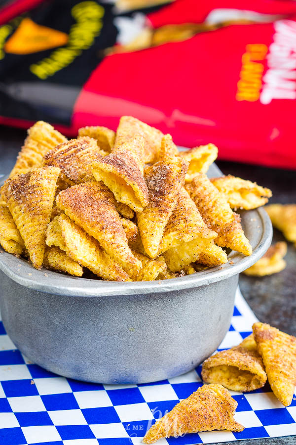 Easy Churro Bugles Recipe - These churros are a sugary delight! It takes just four ingredients and 15 minutes to make this easy snack! #recipe #churros #cinnamon #sugar #snack #recipe