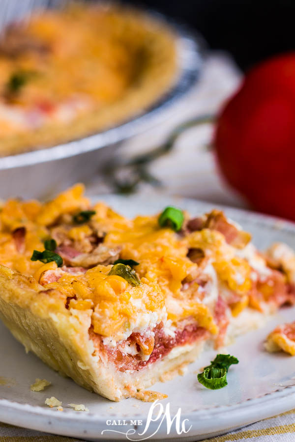 Pimento Cheese Bacon Tomato Pie, this savory, summertime pie recipe is wildly delicious!