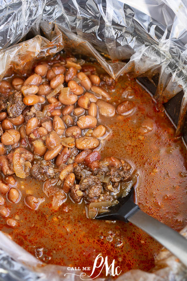 Cooked beans and sausage in a slow cooker