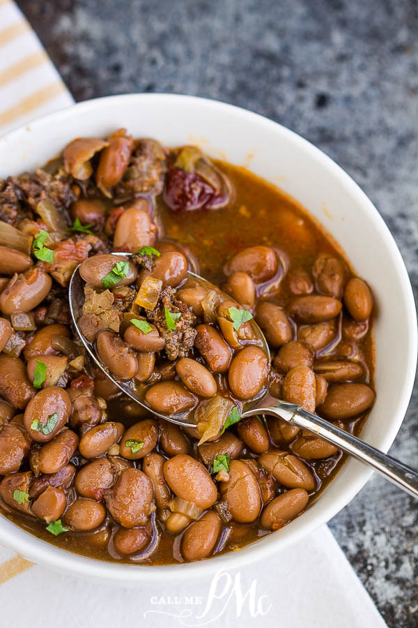 Slow Cooker Pinto Beans and Sausage are simple to make with incredible flavor. These beans slow-cookedall day for some delicious comfort food.