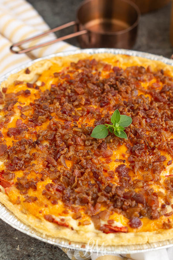 Pimento Cheese Bacon Tomato Pie, this savory, summertime pie recipe is wildly delicious!