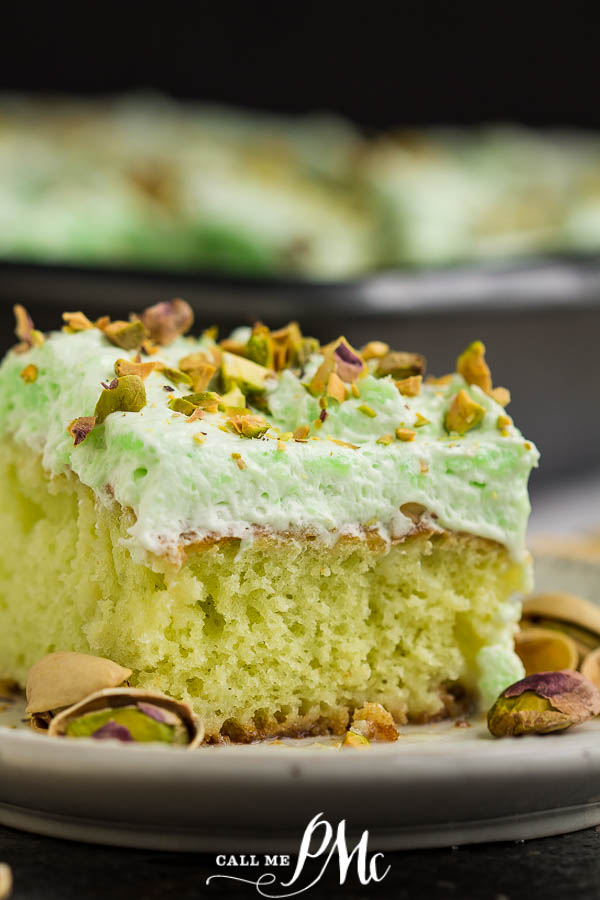 square green cake with green frosting and nuts