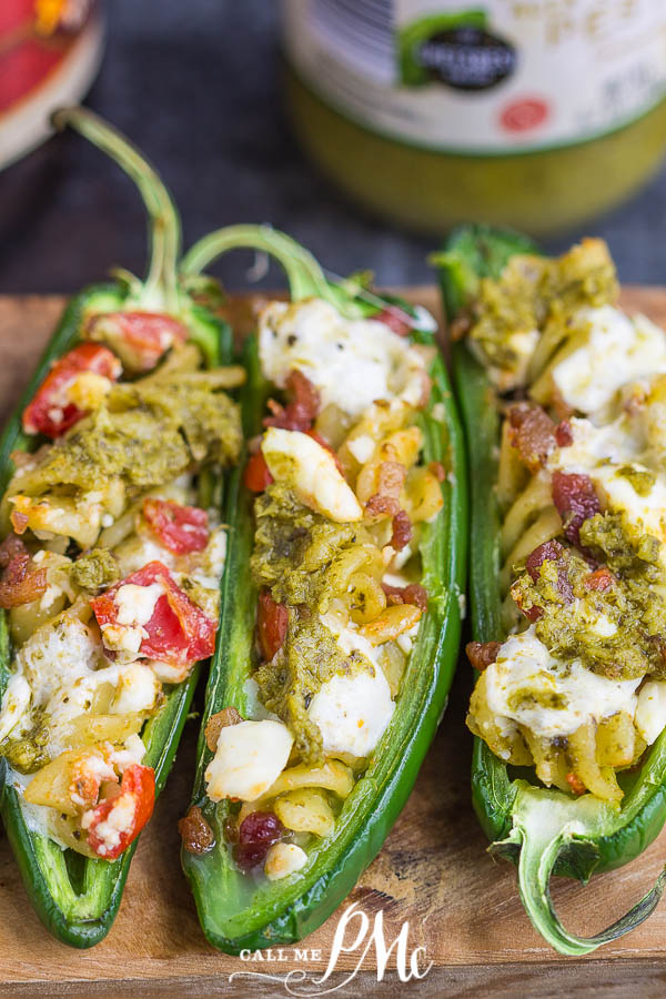 These jalapeno peppers are stuffed with pesto pasta, tomatoes, and cheese. The perfect snack, appetizer, or side.