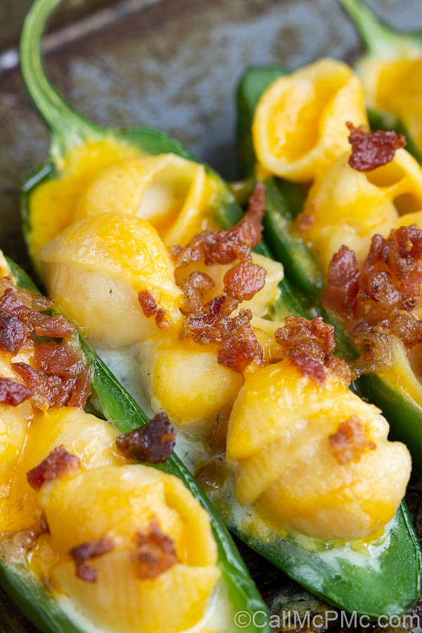 Mac and Cheese Stuffed Jalapeno Poppers are filled with homemade mac and cheese and topped with salty, crispy bacon.