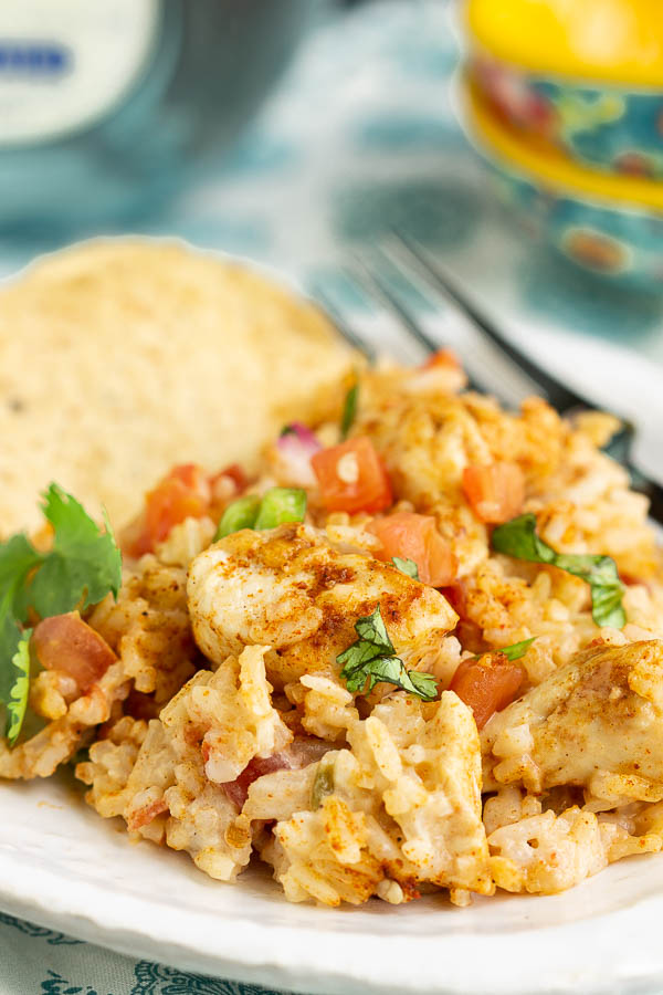 Queso Chicken and Rice Casserole this cheesy rice recipe is loaded with flavor from tomatoes, green chiles, cilantro, pico de gallo, and spices.
