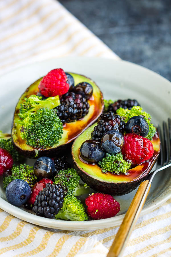 berries, and broccoli filled avocados