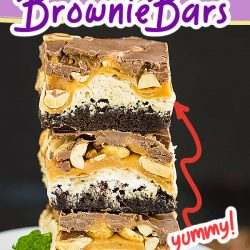 Snickers Brownie Bars - Rich, fudgy brownies are topped with a fluffy nougat, creamy caramel, crunchy peanuts, and dark chocolate.
