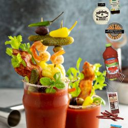 Bloody mary cocktail topped with variety of generous garnishes