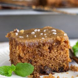 Applesauce Walnut Spice Cake with dates and caramel frosting is a moist, old-fashioned recipe, and one of my family's favorite fall cakes.