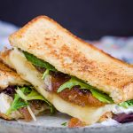 Brie Fig Grilled Cheese - Gourmet grilled cheese sandwich oozing with melted brie cheese and fig preserve nestled between buttery bread! It's out-of-this-world good! #grilledcheese #recipe #sandwich #callmepmc